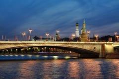 Lights of Festive Bolshoy Moskvoretsky Bridge in Twilight. MOSCOW, RUSSIA - View from Raushskaya embankment of Moskva-Reka Moscow River on illuminated Bolshoy royalty free stock image