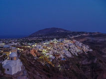 Lights of Fira village at night in Santorini Stock Photography