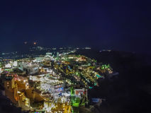 Lights of Fira village at night in Santorini Royalty Free Stock Image