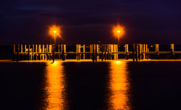Lights on a fishing pier at night, in Havre de Grace, Maryland. Royalty Free Stock Photos