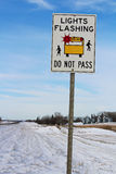 Lights Flashing School Bus Sign Along a Rural Highway Stock Image
