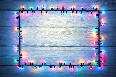Lights Garland Colorful Wood Frame, Holiday Color Light Sign. Lights Garland Colorful Wood Frame, Christmas Holiday Color Light Sign, Wooden Background royalty free stock image