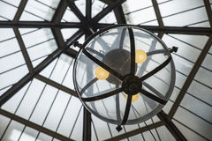 Lights in Glass Globe Hanging From Ceiling. Royalty Free Stock Photos