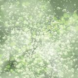 Lights on green background bokeh effect. Vector EPS 10 Stock Images