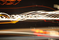 Lights on a highway 3. Photographic play with light and motion while stuck in traffic one night. I wasn't driving stock photo
