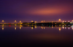 Lights and highways reflecting in the Potomac River at night, se. En from National Harbor, Maryland Royalty Free Stock Photos