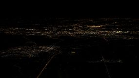 Lights of roads Amsterdam city top view from airplane window at night. Lights of houses and roads of Amsterdam city top view from airplane window at night. Plane royalty free stock photos