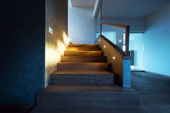 Lights illuminating the stairway in modern house interior Royalty Free Stock Photos