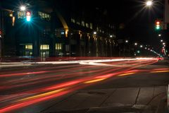 Car Lights intersect. Car lights streaks add color to this night street scene Stock Photos