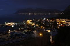 The lights of Kalk Bay Harbour early morning Stock Photos