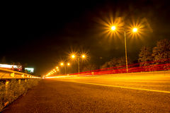 Lights line the roads at night . The car lights line the roads at night Stock Photography