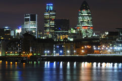 Lights of the London city. Townscape over night, long exposure, reflections in Thames river stock photos
