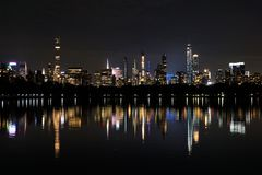 Lights of the Manhattan Skyline Reflecting in a Lake in Central Park. New York, USA royalty free stock photo