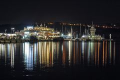 Lights in the Maritime station in Varna. Bulgaria, Night seascape panorama, reflexion on the water ,blurry background Stock Photo