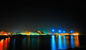 The lights of a mediterranean city by night. And an ancient castle Stock Images