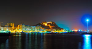 The lights of a mediterranean city by night. And an ancient castle Royalty Free Stock Images
