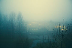 Lights in the mist. With glowing windows Royalty Free Stock Photography
