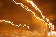 Lights in motion. Abstract lights on the road Royalty Free Stock Photo