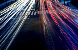 Lights in Motion. Car headlights at night in motion on a busy highway Royalty Free Stock Images