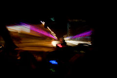 Lights moving. Moving abstract lights from inside a car Stock Images