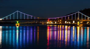 Lights night city and bridge with reflections. On the river Royalty Free Stock Photography