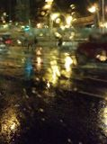 The lights of the night city through the wet glass. Abstract view. stock images