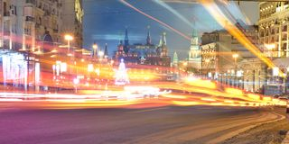 Lights at night Tverskaya street in Central Moscow. Moscow at night, the Lights from passing cars, Tverskaya street in the winter Royalty Free Stock Photo
