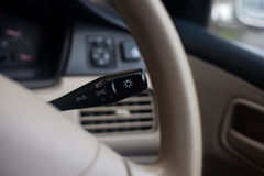 Lights on/off switch in a car Royalty Free Stock Images