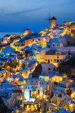 Lights of Oia village at night. Santorini, Greece Royalty Free Stock Photos