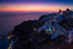 Lights of Oia village at night, Santorini, Greece. Royalty Free Stock Image