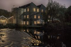 Night view of an old mill reflected in the river stock photography