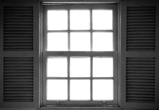 Old window with a hardlight outside royalty free stock photo