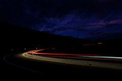 Lights of passing cars on the road at night Stock Image