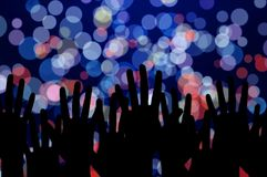 Lights and people hands on night music concert Royalty Free Stock Photos
