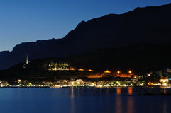 Lights of Podgora at night with Biokovo mountain. In background. Podgora, Croatia Stock Photography