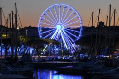 Lights in the port of Antibes France, ferris wheel Stock Image