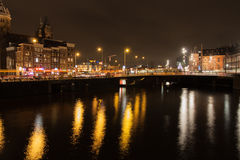 Lights and quays of Amsterdam. The photo shows the quays of Amsterdam at night Royalty Free Stock Images