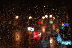Lights through rainy window stock photo