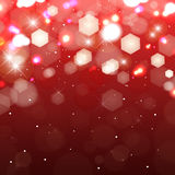 Lights on red background. Shimmering colored light Royalty Free Stock Images