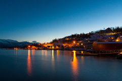 Lights reflecting in fjord near Sjursnes village, Norway Royalty Free Stock Photography
