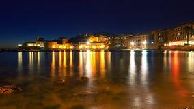 Lights reflection - Baia del Silenzio by night. Sestri Levante - Ligurian sea royalty free stock photography
