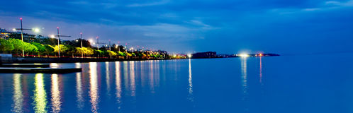 Lights reflection in the sea. A picture of a blue sea and lights reflection,in  greek town thessaloniki Stock Image