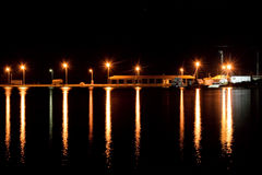 Lights reflections. Night refletions from city lights in the water near the port, in a small greek town Nea Moudania,in a summer night Royalty Free Stock Photos