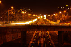 Lights in the road near the bridge in the night city stock photography