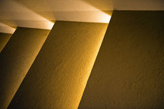 Lights and shadows. An abstract view of several panels with subdued back-lighting or light shining from behind Royalty Free Stock Photography