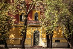 Lights and shadows on building. Cityscape Tirana Ministerial Buildings in Autumn. Light between shadows on old historical facade Stock Photos