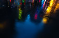 NYC streets after rain with reflections on wet asphalt Stock Photos