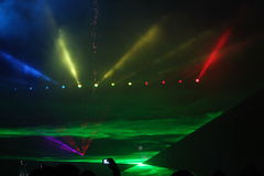 Lights show. With colored spotlights and lasers Royalty Free Stock Photo
