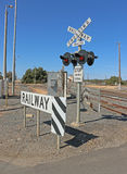 Lights and signs at a three-line railway crossing Royalty Free Stock Images
