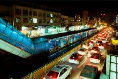 Lights of speedy automobiles and metro station Stock Photos